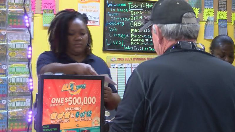 A customer purchases lottery tickets in this file undated file photo.