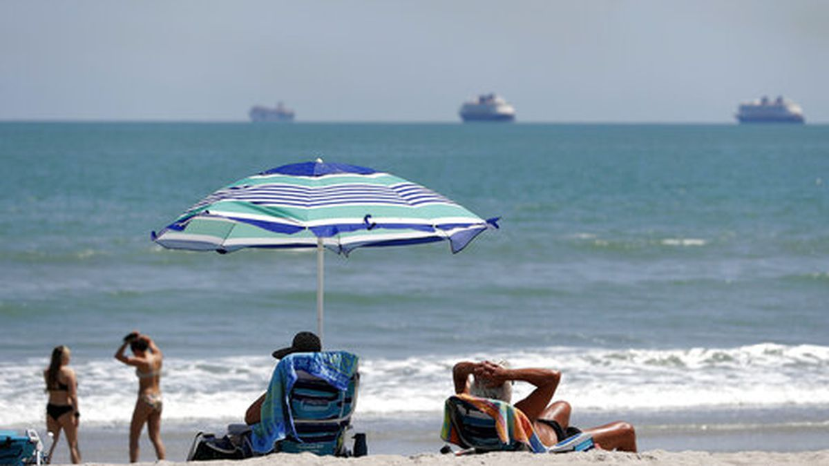 Despite a stay at home policy due to the coronavirus in Florida, beach goers enjoy the sun as...