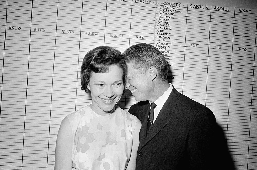 FILE - In this Sept. 15, 1966 file photo, then Georgia State Sen. Jimmy Carter hugs his wife,...