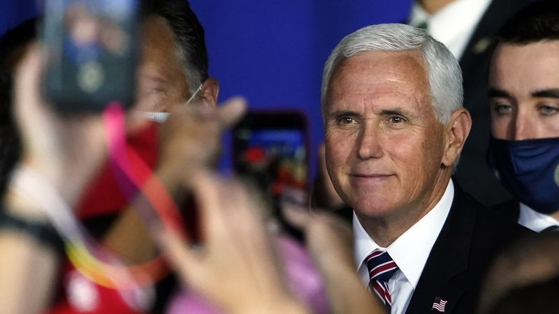 Vice President Mike Pence greets supporters after speaking at a campaign rally, Tuesday, Sept....