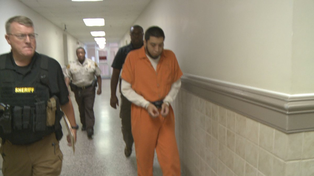 Rolando Castillo, Jr. is led from a Houston County courtroom in this June 1, 2018 photo.