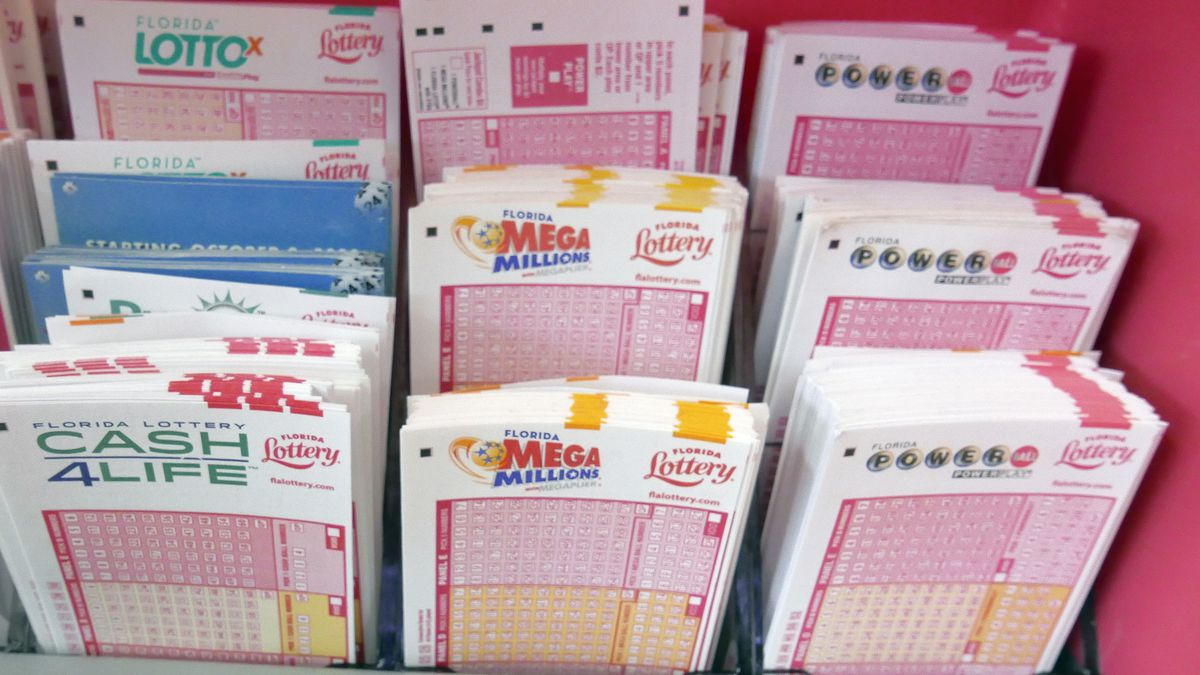 Mega Millions lottery tickets, center, and Power Ball tickets, right, are seen with other...