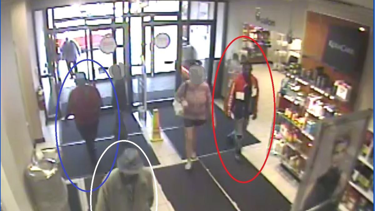 In the picture above, one person can be seen wearing a white, red, and black jacket, another one is in a tan jacket, and the third is in a red shirt and dark pants. (Dothan Police Dept.)