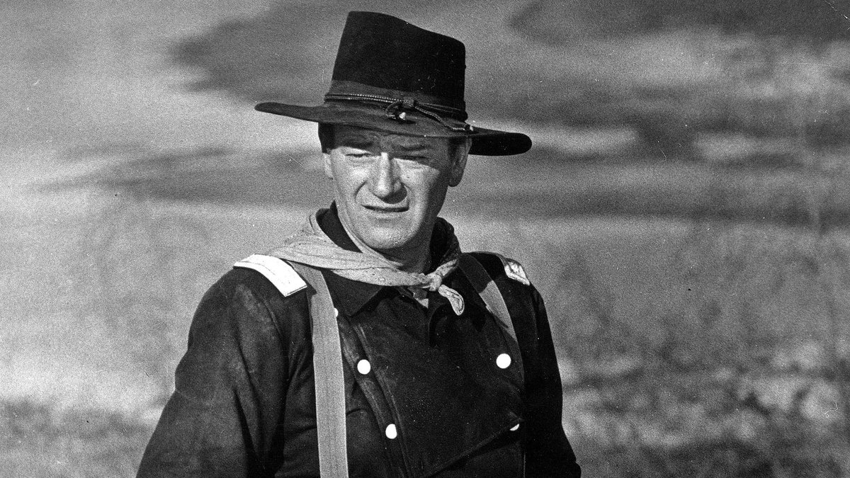 """In this undated photo, John Wayne appears during the filming of """"The Horse Soldiers."""" In the..."""