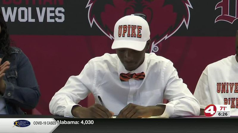 On the dotted line: Faison signs with Pikeville