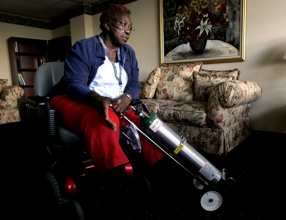 Lourene Mack, 76, relaxes in the sitting room of the Mildred and Claude Pepper Towers, a senior...