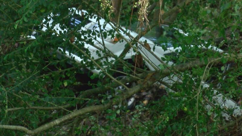 White van swept away in Arab flood waters.