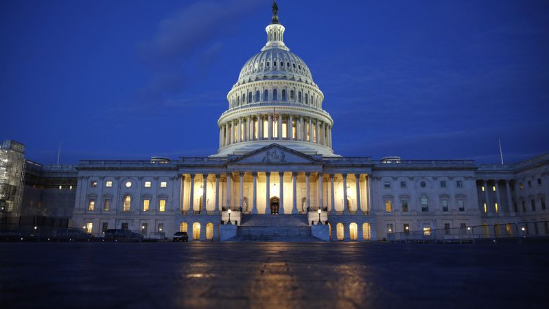 Light shines on the U.S. Capitol dome in Washington. (AP Photo/Patrick Semansky)