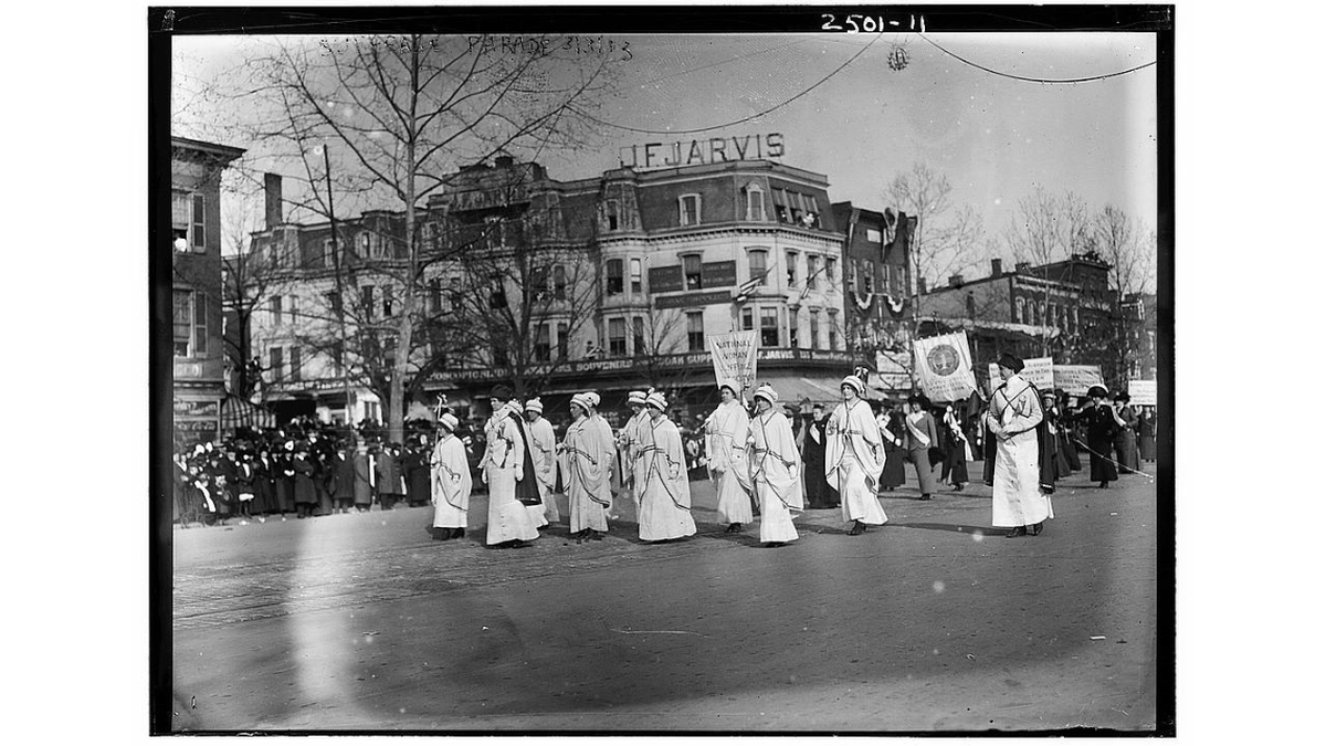 """Women marching with banner """"National Woman Suffrage"""" at the Woman Suffrage Parade in Washington, D.C., March 3, 1913. (Photo: Library of Congress via Flickr Commons project)"""