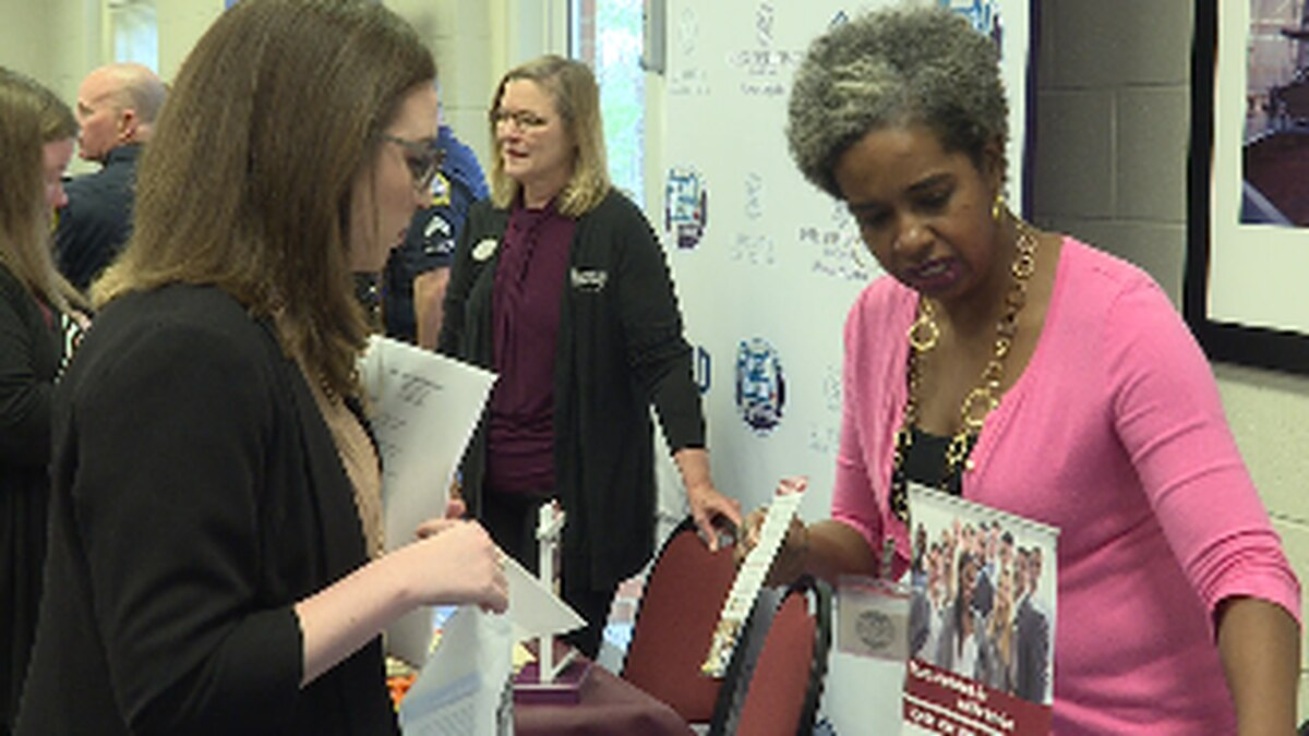 Career seeker and Employer conversing at a career fair in Troy-Dothan