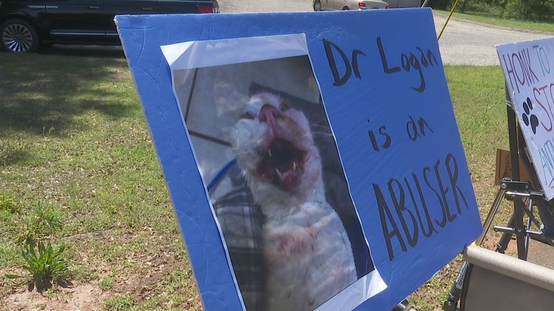 Sign outside the office of Dr. Tim Logan, the Ozark veterinarian charged with animal cruelty.