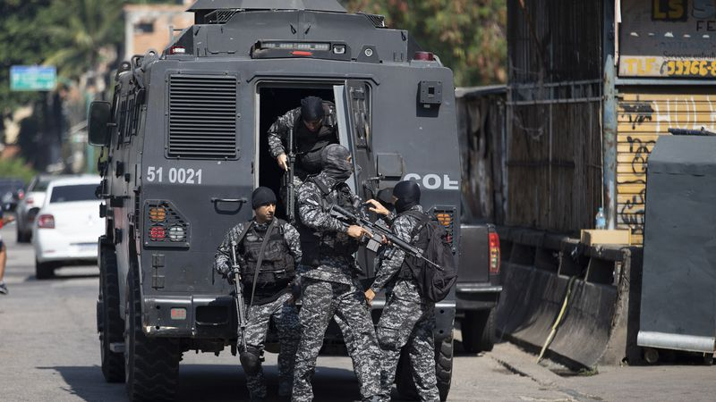 Police get out of an armored vehicle during an operation against alleged drug traffickers in...