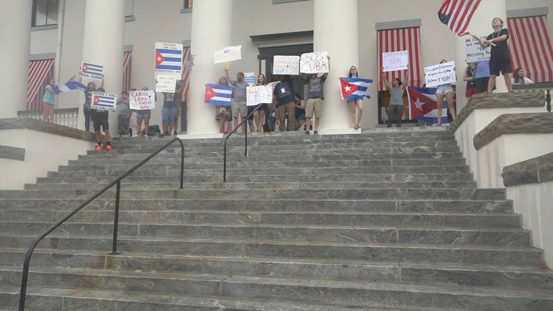 Protesters gathered under Old State Capitol Building in support of Cuba.