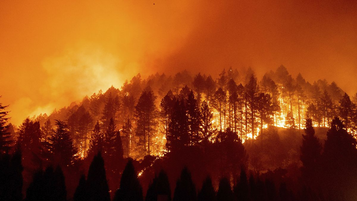 FILE - The Glass Fire burns a hillside above Silverado Trail in St. Helena, Calif., on Sunday, Sept. 27, 2020.