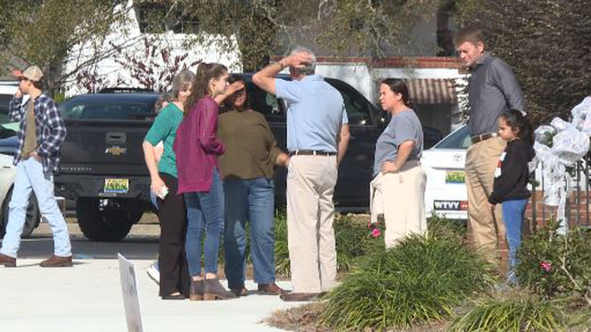 Members of the Geneva community gather to grieve and support each other after three teens were...