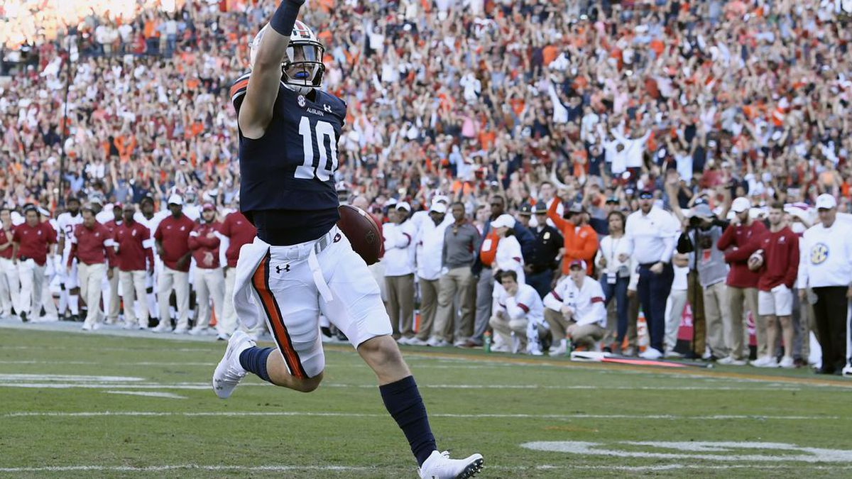 Bo Nix (10) scores in the first half. Auburn v Alabama Iron Bowl on Saturday, Nov. 30, 2019 in Auburn, Ala. Todd Van Emst/AU Athletics (Source: Todd an Emst/AU Athletics)