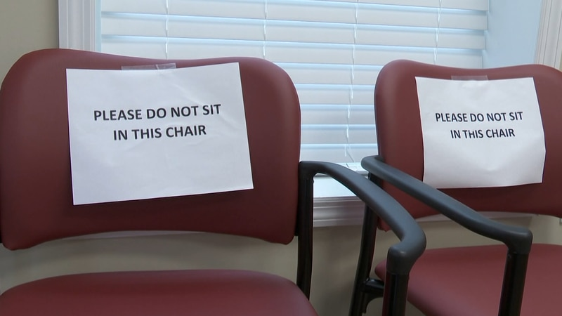 Waiting rooms stay empty while patients are to wait in their cars until it is time for their...