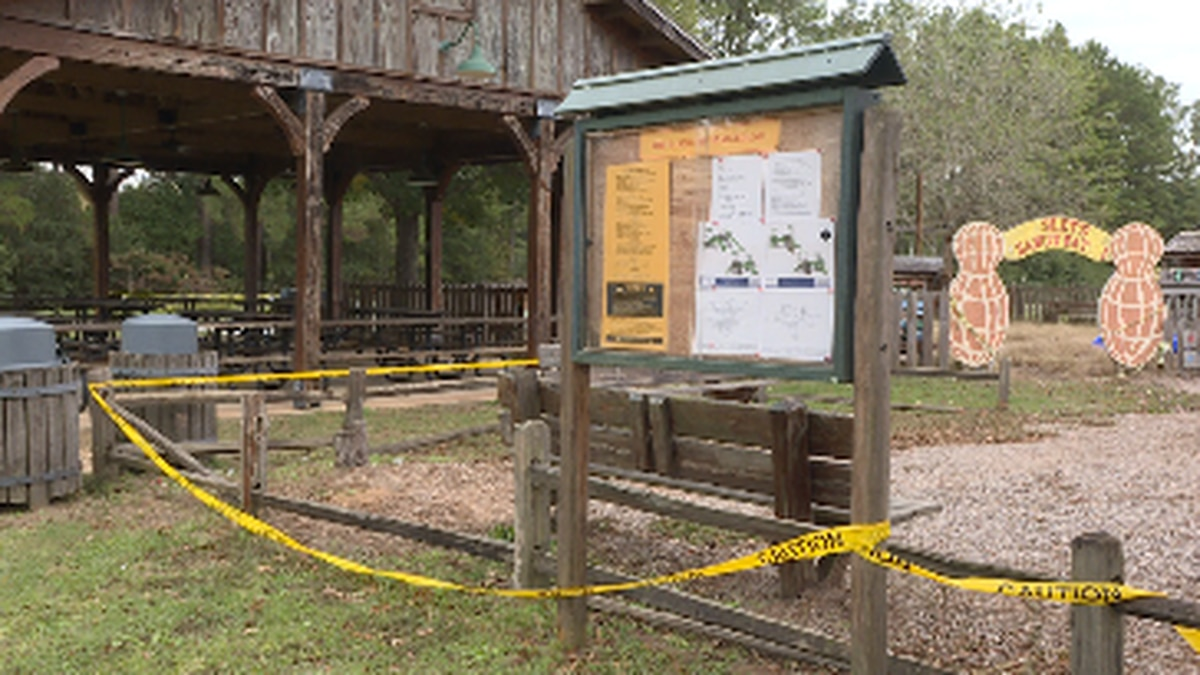 Caution tape surrounds what's left of the old playground, which is being torn down to make way for a new set. (Source: WTVY)