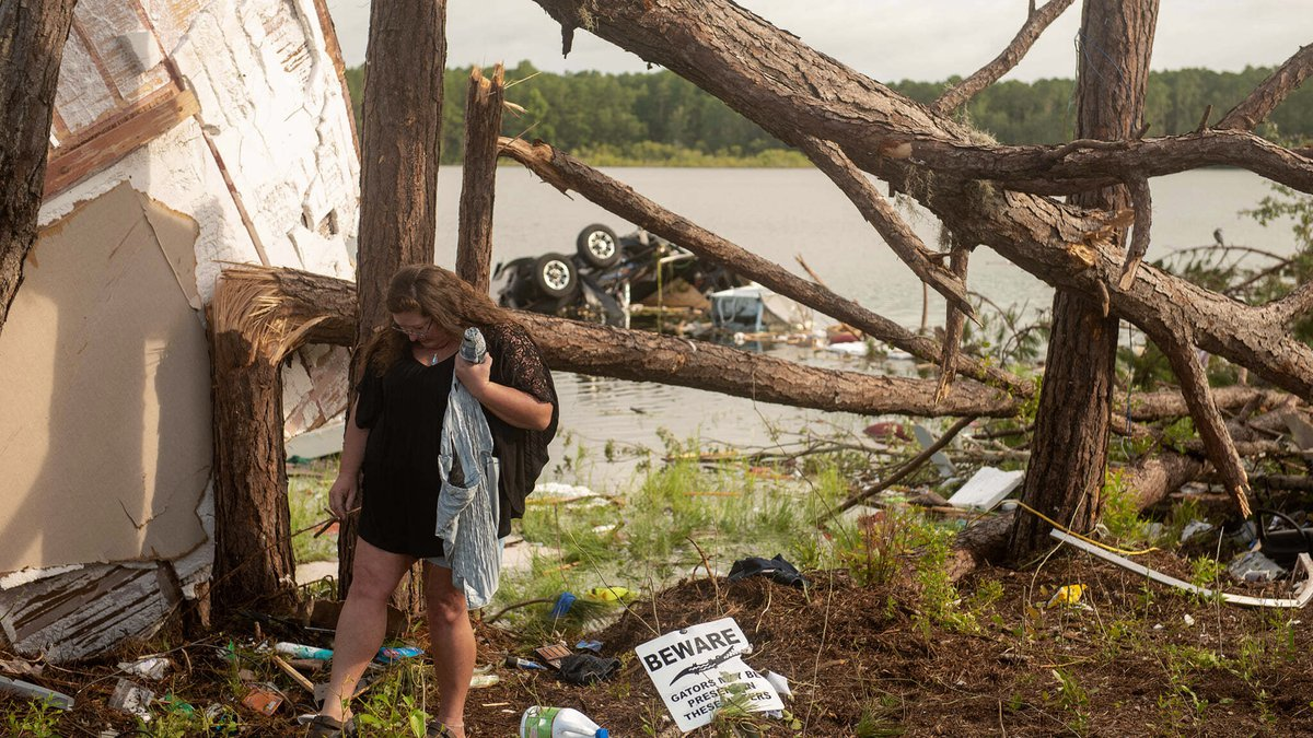 This photo provided by the U.S. Navy, Missy Lattanzie, an RV park resident, searches through...