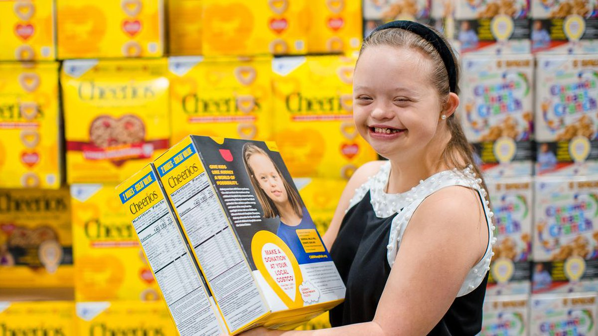 Aubrey Armstrong smiles while checking out her photo on boxes of Cheerios at the Ridgeland...