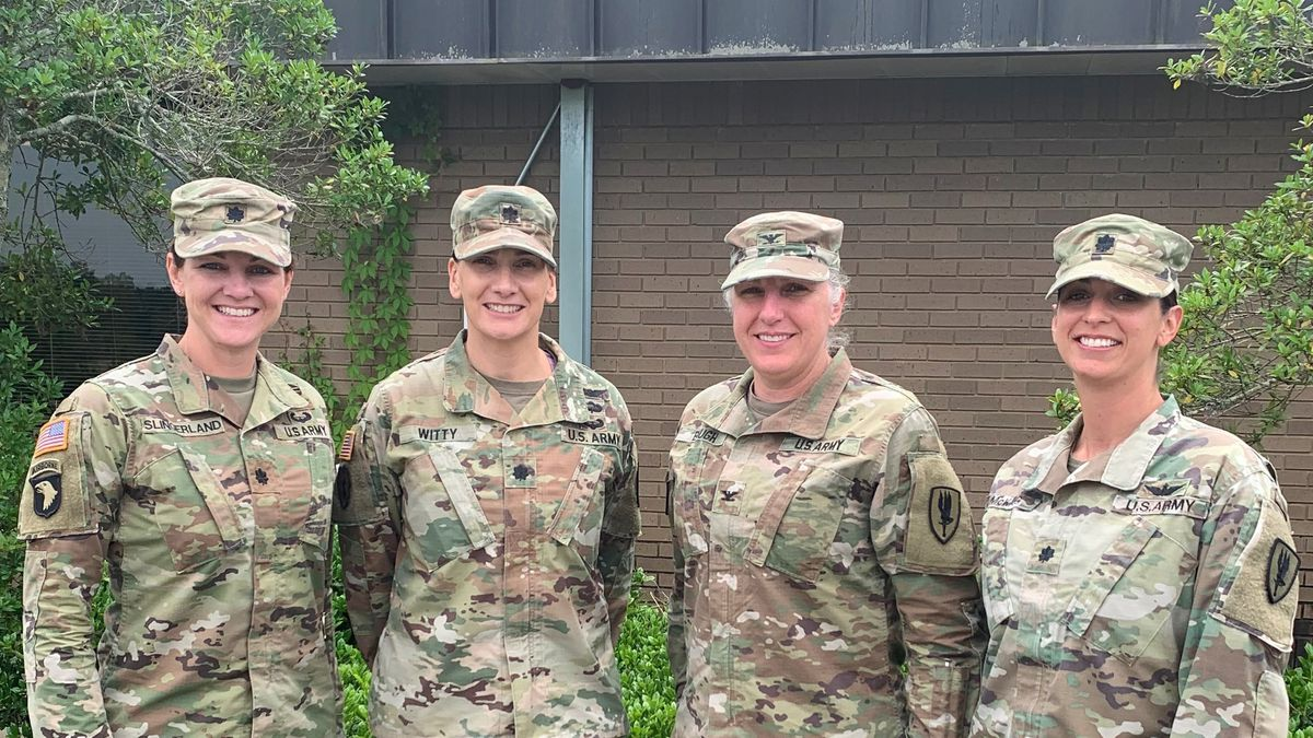 Women in command of the U.S. Army's 1st Aviation Brigade stand together at Fort Rucker,...