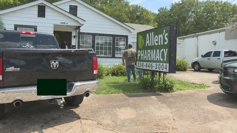 Federal agents and local officers serve a search warrant at Allen's Pharmacy on July 8, 2020.