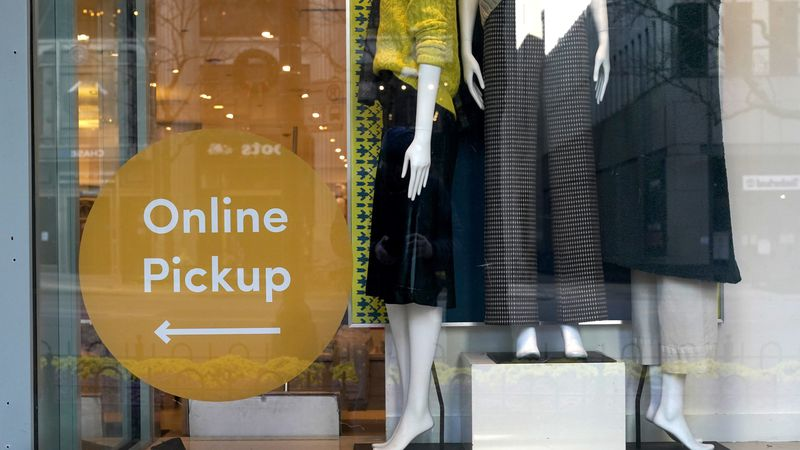 Mannequins stand on display Wednesday, Nov. 18, 2020, at the Ann Taylor store with an online...