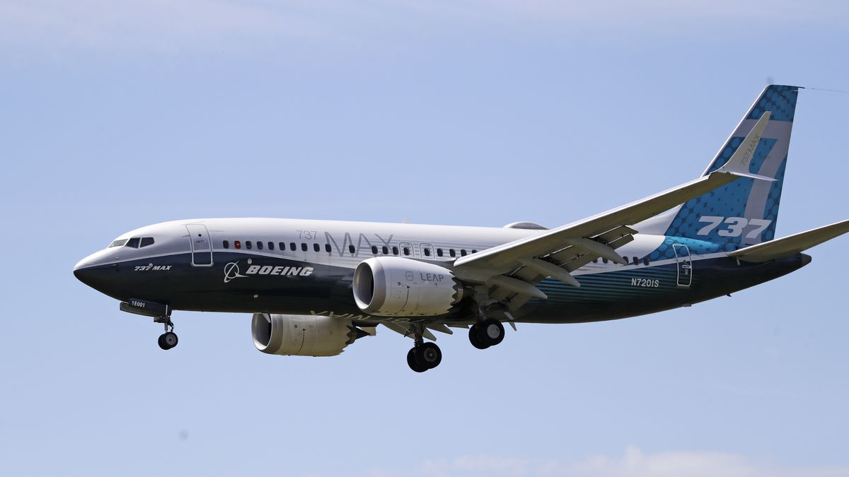 FILE - In this Monday, June 29, 2020, file photo, a Boeing 737 Max jet heads to a landing at Boeing Field following a test flight in Seattle. A U.S. House committee is questioning whether Boeing and the Federal Aviation Administration have recognized problems that caused two deadly 737 Max jet crashes and if either organization will be willing to make significant changes to fix them.