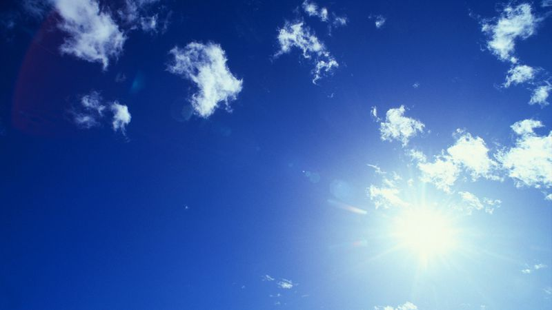 Sun and Cirrus Clouds --- Image by © Royalty-Free/Corbis