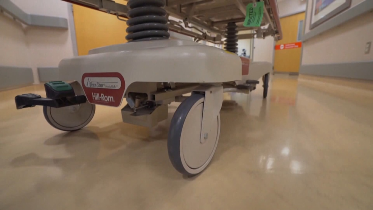 Hospital bed rolling down the hallway.