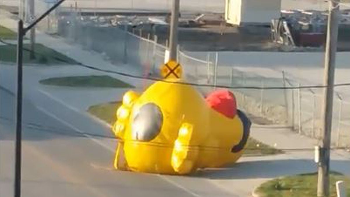 A screen grab from a video posted on Twitter shows an inflatable duck blowing down a Des Moines...