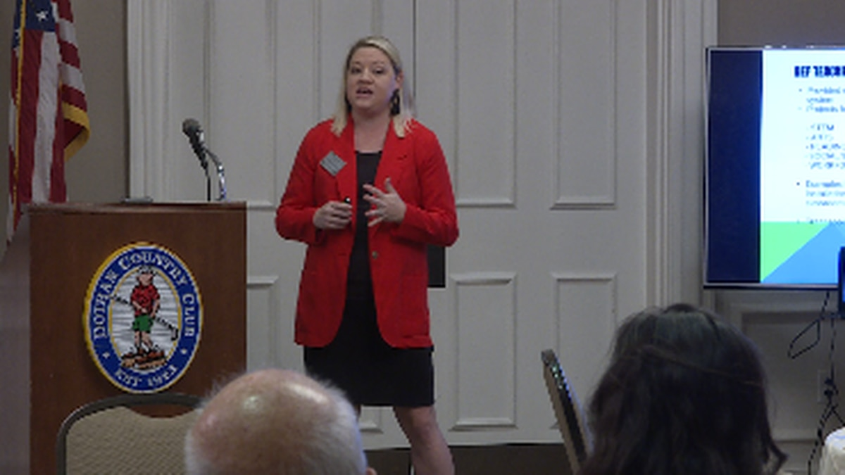 Dothan Education Foundation Exec. Director Lindsey Fountain explains to club members how the...
